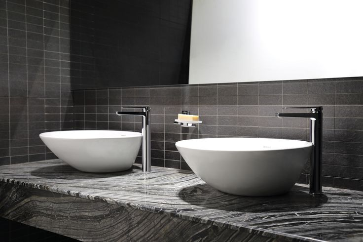 Beautiful double basins with high riser facuets