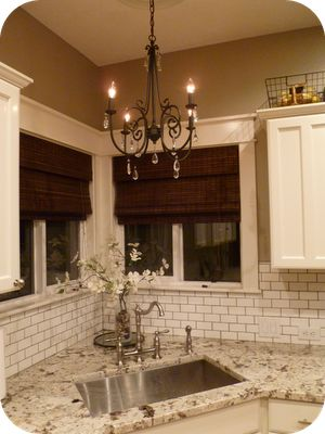 Pottery Barn Audrina chandelier- love the chandalier and subway tile!!