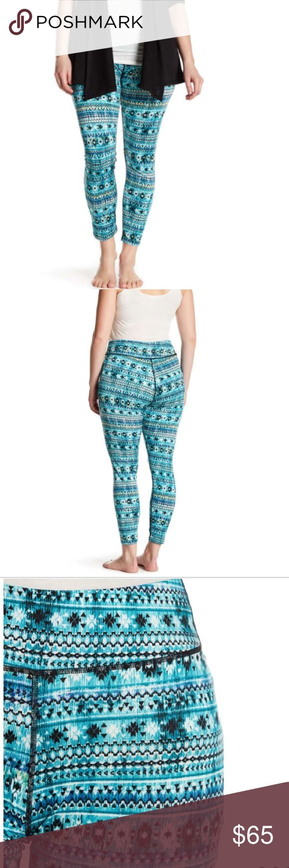 """ELECTRIC YOGA plus size pattern leggings These beautiful turquoise patterned leggings for curvy ladies will stick with you through every season of the year! Spring summer fall winter. Pattern contains blue black and white.  - Elasticized waist - Allover print - Seaming detail - Skinny leg - Stretch construction - Approx. 11"""" rise, 28"""" inseam (size 1X) - Imported  -96% polyester 4% spandex  -true to size Electric Yoga Pants Leggings"""