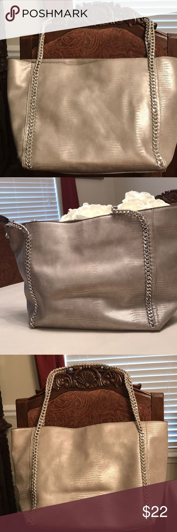 Mossimo silver tote bag with chain straps This bag is super roomy and cute. Silver metallic , almost looks like snakeskin with the chain straps. Used twice. In excellent condition. Mossimo Bags Shoulder Bags