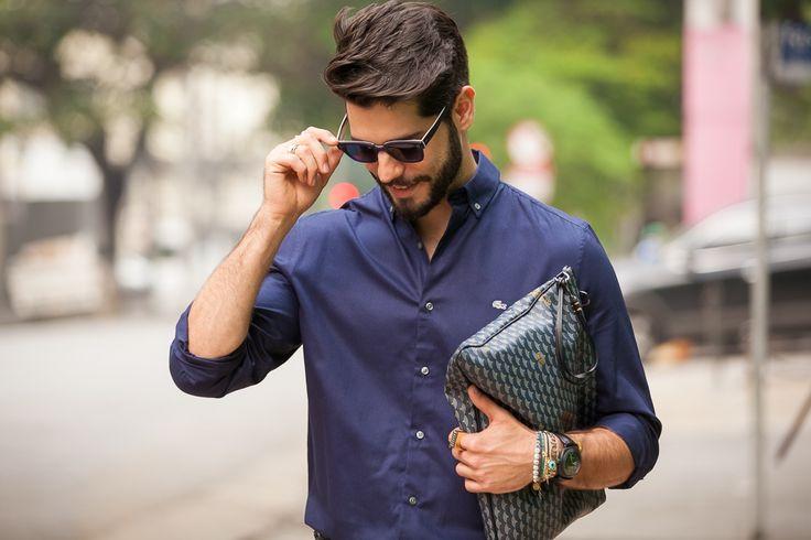 Mens Street Style: Fashion journalist, Kadu Dantas, is armed for seduction with the Fauré Le Page Pochette Zip in Paris Blue.