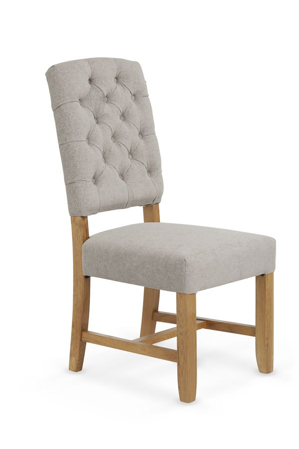 The Belmont Silver Grey Fabric Dining chair has an eye catching traditional design with chesterfield style buttoned back, combined with a choice of contemporary chenille fabrics to suit any setting.  All of the frames are ready assembled at manufacturing stages, and the timber is solid oak throughout.  For Full description and sizes see below.   FREE DELIVERY 3-4 DAYS PRICED PER CHAIR