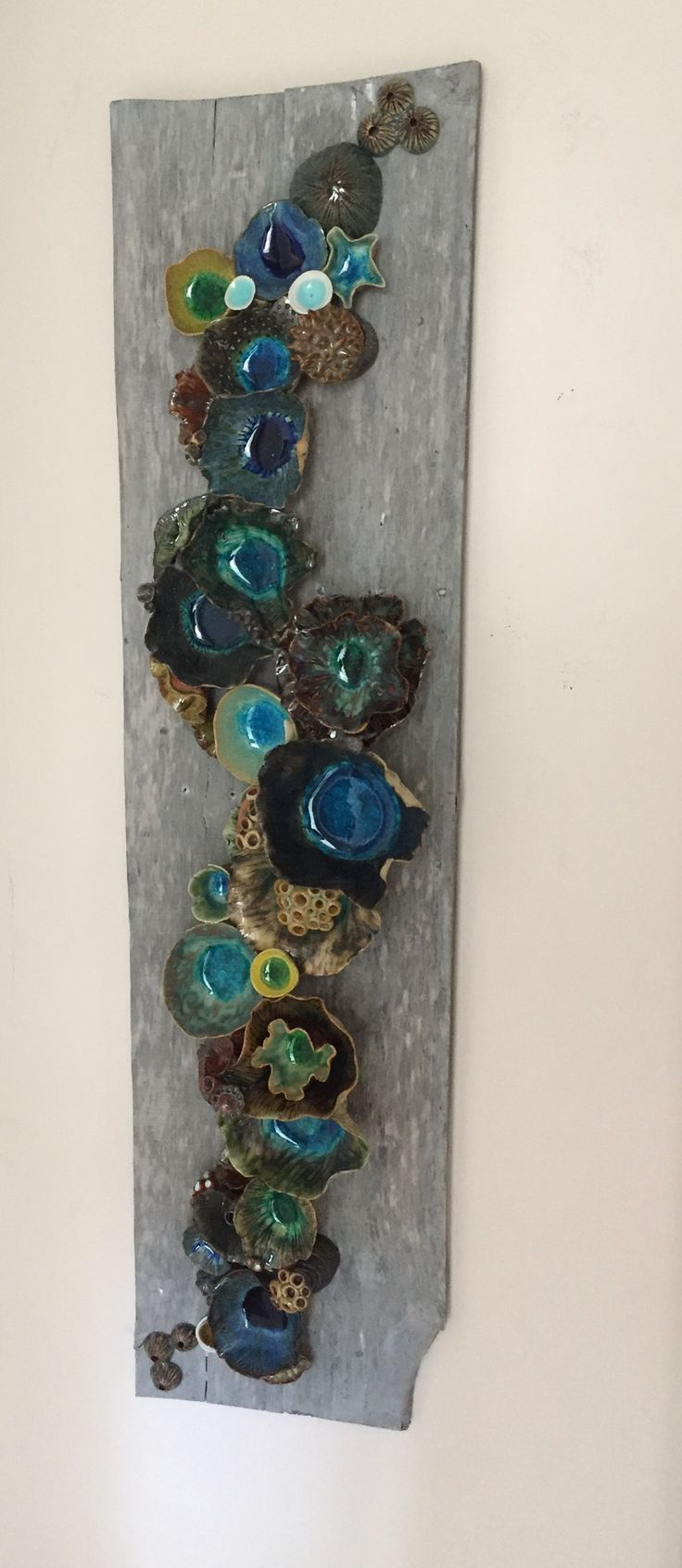 """Wall ceramic sculpture depicting corals and barnacles. Size: 40"""" x 12"""". Reclaimed Wood Wall Art; Ceramic Coral Reef Wall Application; Ocean Reef; Underwater Coral Reef Pieces are handmade individually"""