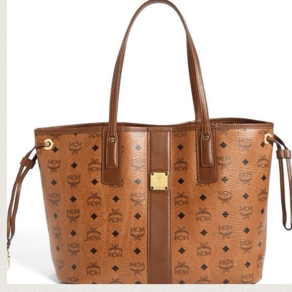 """MCM 'Medium' reversible (NO TRADE) includes pouch Gently used. In great condition. Perfect bag for all occasion and outfits. It's a great carry all!  SIZE 14 ¼""""W x 10 ½""""H x 6 ½""""D. (Interior capacity: large.) Pouch: 11 1/2""""W x 8""""H x 1/2""""D. 10 ½"""" strap drop. 1.5 lbs. MCM Bags Totes"""