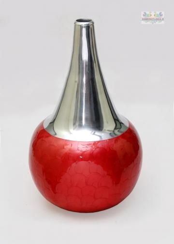 This round shaped vase is splendid as home decor item. Keep fresh or dry flowers inside it and display in living room and other spaces to attract people instantly. The vase in made of aluminium has gorgeous designs in red color.
