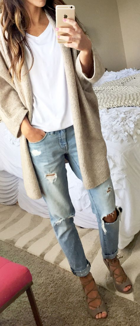 oversized beige knit + ripped denim Such a great way to dress up boyfriend  jeans!