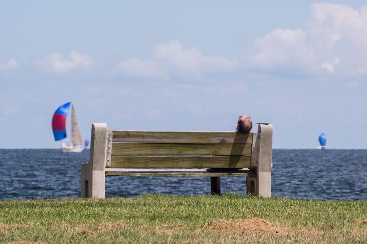 Man dozing off on a bench on Lake Pontchartrain