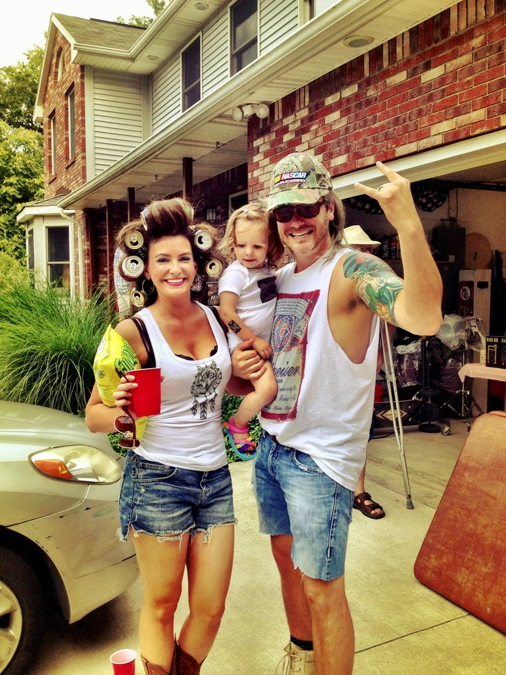 Redneck family Halloween costumes.  Complete with confederate flag iron on onesie, Budweiser tee for dad, bud light or natural ice for the boy.  All made with iron on paper you can get at any office supply store.  Mullet wig for dad, nascar hat.  Don't forget the beer can rollers for mom if your hair is long enough, if not, the little pink foam ones will work too.  Top it off with some killer light blue eyeshadow :)