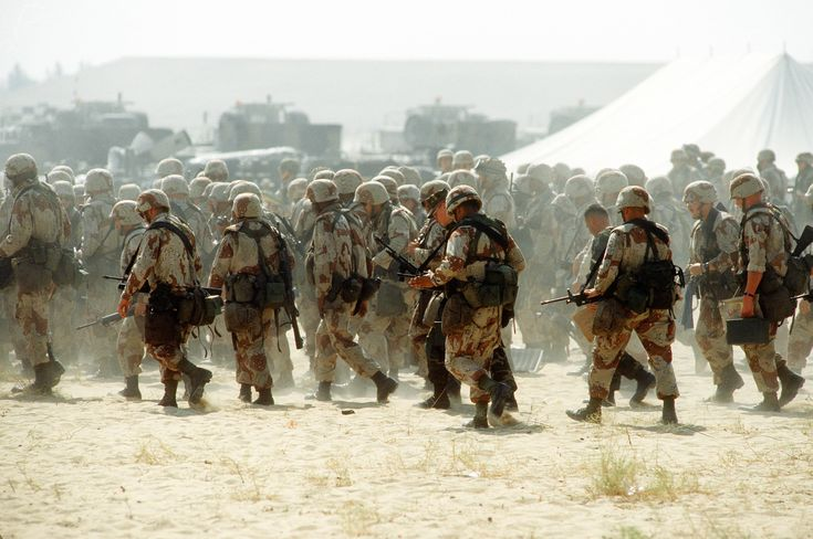 U.S. military personnel arrive at a base camp during Operation Desert Shield. U.S. Army photo by Staff Sgt. Lee Corkran
