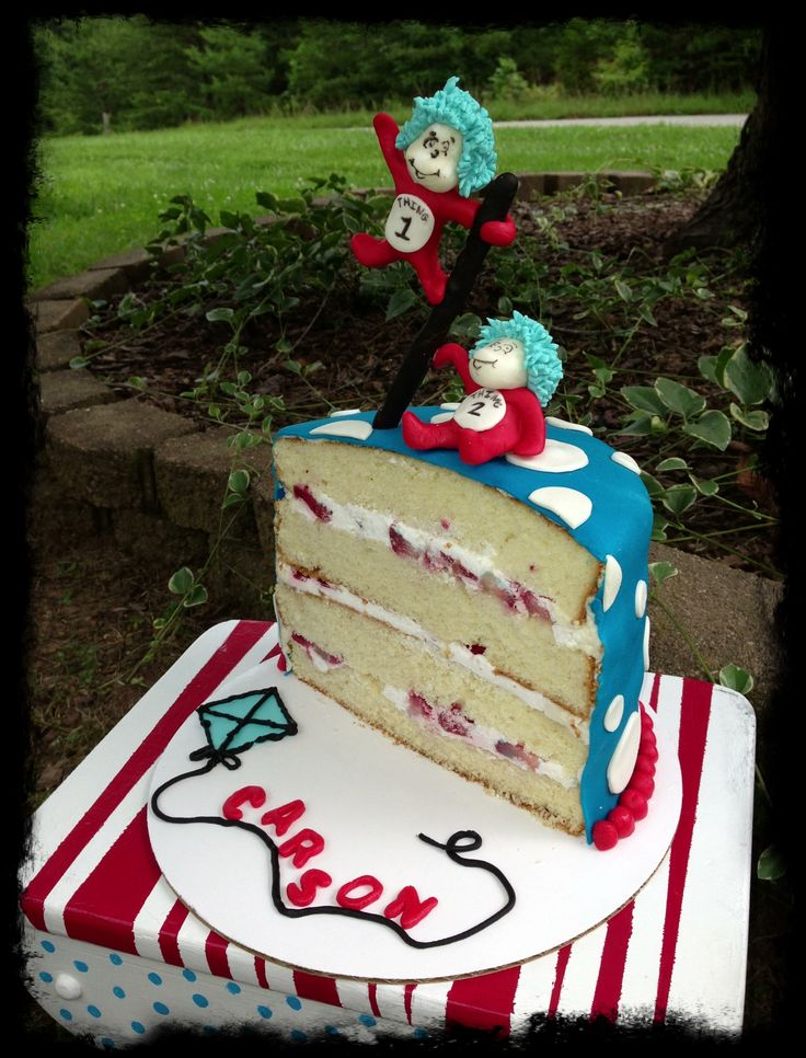 My baby boy's 1/2 birthday cake. Dr. Seuss half birthday cake with a thing 1 and thing 2 topper.