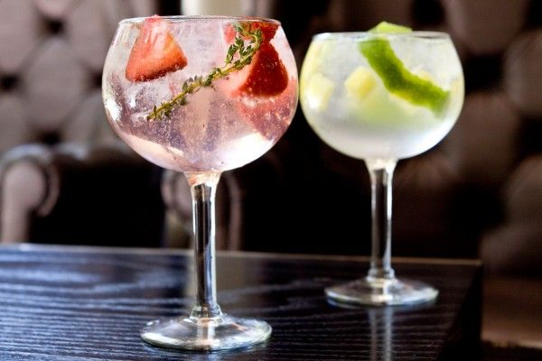 Madrid-Style G   2 oz Tanqueray Malacca   6 to 8 chunks pineapple, diced  Peel of one lime  One bottle of Fever Tree tonic  Build over good ice in a large goblet.    2 oz Bluecoat gin   3 ripe strawberries, sliced   3 sprigs thyme  One bottle of Fever Tree tonic