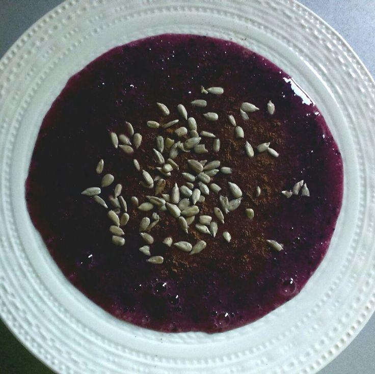Finnish style porridge with four cereals, blueberries, cinnamon, sunflower seeds