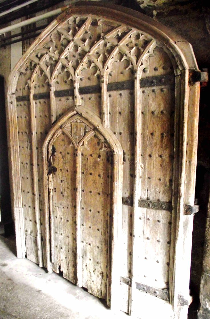 14th century door into the Vicars Choral cloister at Hereford Cathedral. Said to be reused from the vanished medieval choir screen. [Photo Philip Weaver]