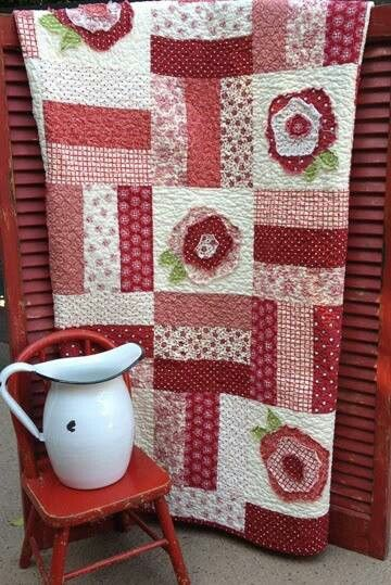 Just plain strips and alternate with cabbage rose pattern...makes for a warm cozy feel. Ha!  I've made these roses for several quilts now...like mixing it up with easy blocks in between.