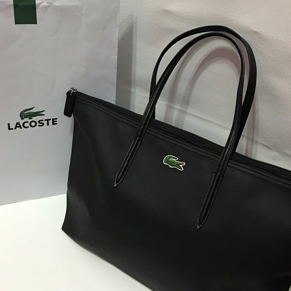 LACOSTE Large Shopping Bag AUTHENTIC. Color: Black. Condition: very good and barely used. I still have the original tag inside the bag (@the zipped pocket). It has zip top closure and 1 ring has a little discoloration but can hardly be noticed. Comes w/ lacoste paper bag. Lacoste Bags Totes