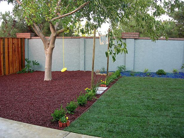 Create outdoor kid's play area - like the visual separation of area with mulch etc.