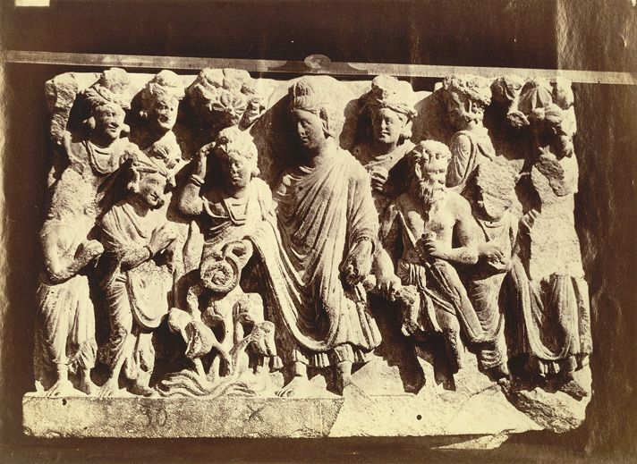 Photograph taken in c.1883 and attributed to Henry Hardy Cole (probably incorrectly) of a Buddist sculpture slab, representing Buddha with a snake in his alms bowl, from an unknown location near Peshawar in the North West Frontier Province and now in the Lahore Museum. This sculpture illustrates the miracle at the fire-temple, where, Buddha subdued a dangerous serpent which had taken up residence at the temple through his spiritual power. Once subdued the snake crawled into the Buddha's…