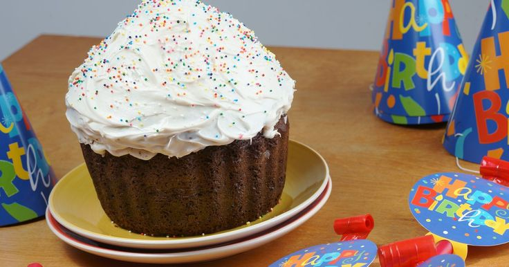 Baking a giant cupcake is a fun play on the birthday and wedding individual cupcake trend of recent years. A two-piece silicone mold, which ensures even baking, allows you to create the treat in a manner much like making a traditional layer cake. After baking the layers, the two halves are assembled to make one large cupcake that you may decorate...