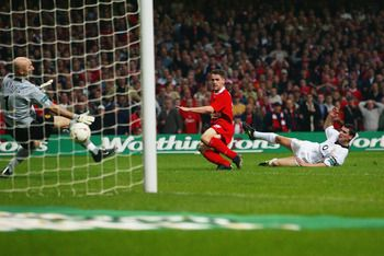 CARDIFF - MARCH 2:  Michael Owen of Liverpool scores the second goal during the Worthington Cup Final between Liverpool and Manchester United held on March 2, 2003 at the Millennium Stadium, in Cardiff, Wales. Liverpool won the match and final 2-0. (Photo