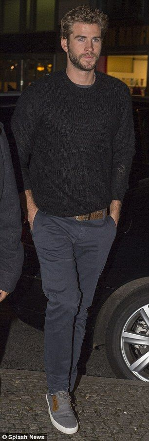 Hunky: He added grey chinos, a tan leather belt and grey, white-soled trainers...