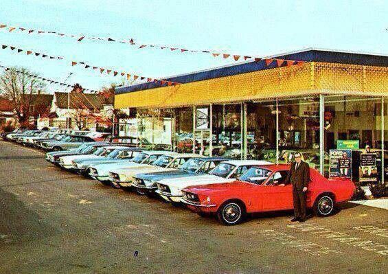 Mustangs sitting on the lot in the sixties. God, take me back!!