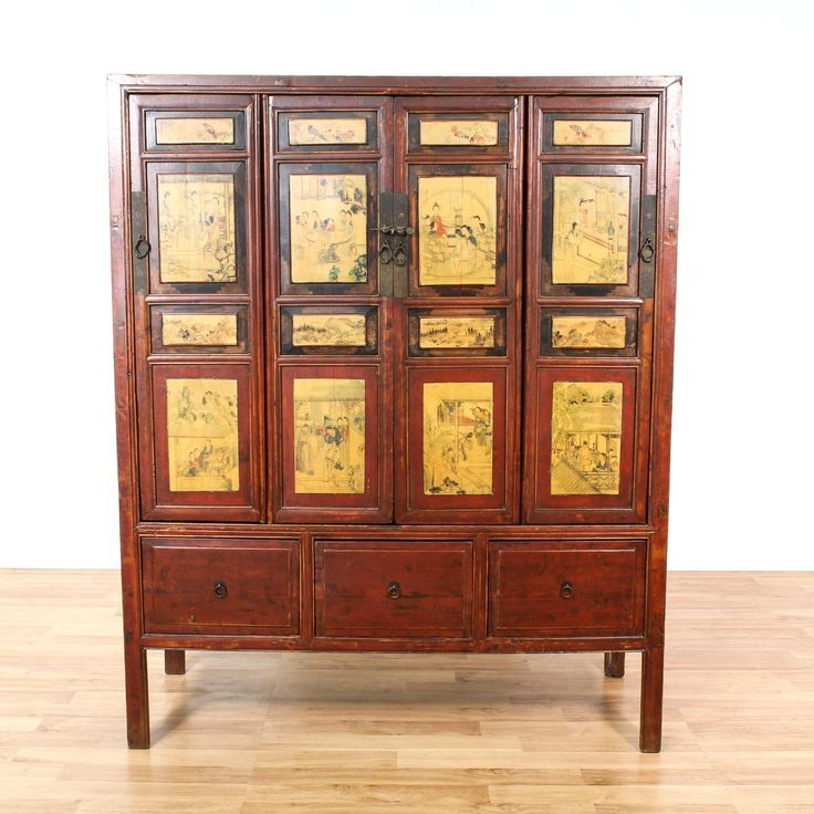 This Chinese armoire is featured in a solid wood with a distressed cherry finish. This large antique wardrobe has 4 carved panel doors with painted chinoiserie scenes, 3 large drawers and tons of interior storage space with shelving. Eye catching vintage storage piece perfect for additional closet space! #asian #dressers #armoireorwardrobe #sandiegovintage #vintagefurniture