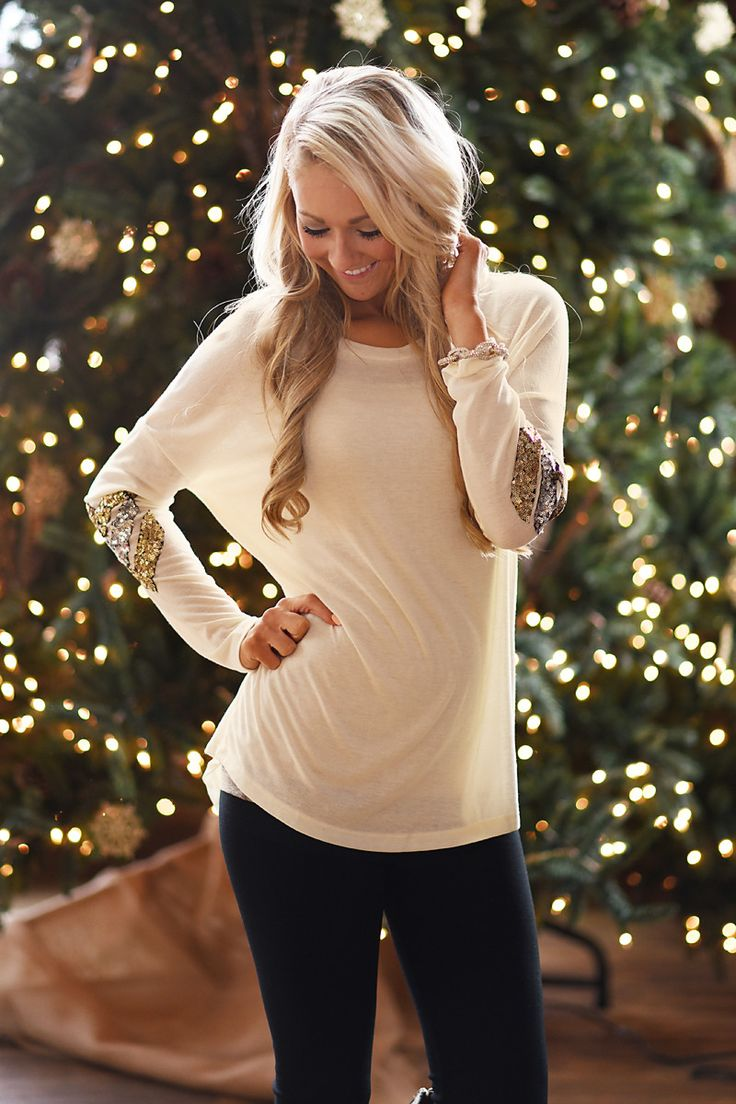 Dazzle me in cream long sleeve tunic with glitter sleeves.