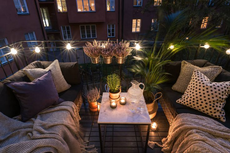 Make the most of your outdoor space, no matter how big or small. This cosy balcony is ideal with festoon lights.