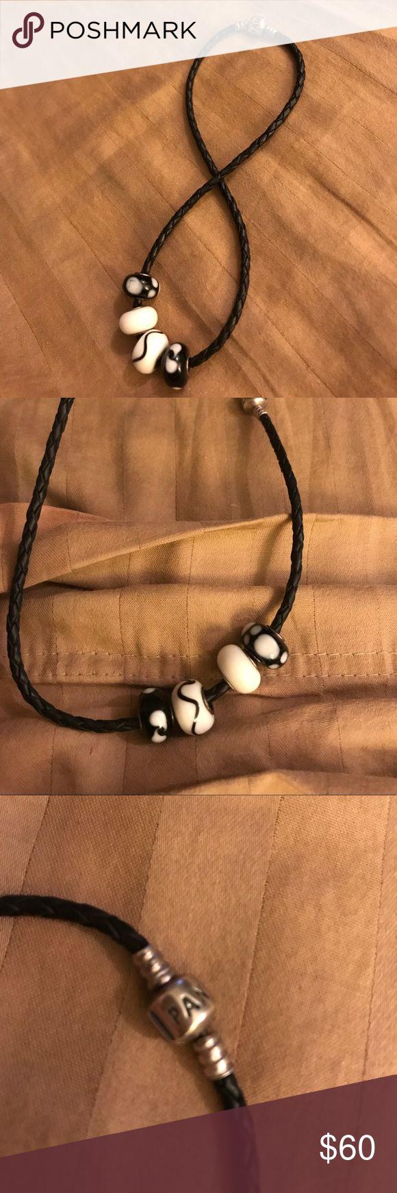 Pandora black rope bracket with 4 charms Pandora rope bracelet with 4 charms that are not pandora Pandora Jewelry Bracelets