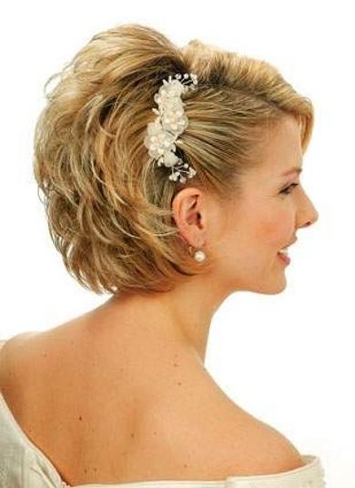 acconciatura sposa con capelli corti. Guarda altre immagini di acconciature sposa: http://www.matrimonio.it/collezioni/acconciatura/2__cat