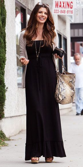 Black maxi with pink sweater and long necklace