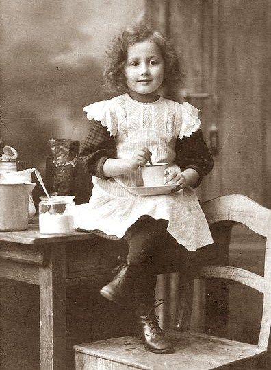 No doubt this little lass is enjoying a cup of tea. Something about her countenance touches me - a kindness in her eyes even at her young age.
