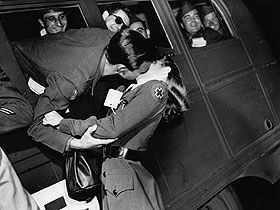 Soldier kissing Nurse WWII - 1945 by American Red Cross Oregon Trail Chapter, via Flickr