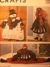 McCall's pattern for draft dodger, hanging snow lady, more...one of many patterns sold on website http://barbspencerdolls.com  http://barbspencerdolls.com/patterns/