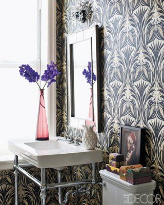 Like the idea of a bathroom with pattern wallpaper on the sink wall