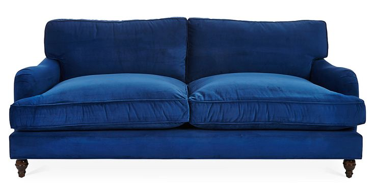 """T-shape cushions and a graceful side curve give a refined look that adds relaxed elegance to this 90"""" sofa. Upholstered in vibrant sapphire, it will add a bold touch of luxe style to any room it's..."""