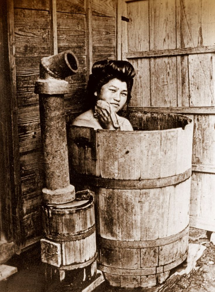 Woman in hinoki ofuro (bathing barrel), ca.1910-15 by T. ENAMI