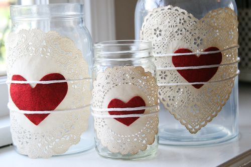Easy Valentine's Day Jars - cut hearts out of red felt and attach hearts to paper doilies (I would use a bit of hot glue), then tie around jars with baker's twine. Great little, inexpensive way to add a 'pop' of romance to your decor. I would also add a variety of different candies and/or candles inside the jars.