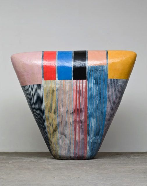 Jun Kaneko's technique involves the use of masking tape and colored slips, which he uses to covers free-standing ceramic forms and wall-hung pieces with graphic motifs and markings