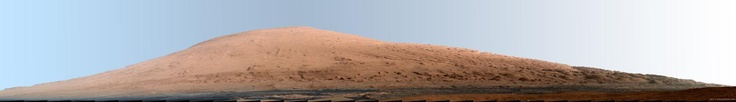 This mosaic of images from the Mast Camera (Mastcam) on NASA's Mars rover Curiosity shows Mount Sharp in a white-balanced color adjustment that makes the sky look overly blue but shows the terrain as if under Earth-like lighting. White-balancing helps scientists recognize rock materials based on their experience looking at rocks on Earth. The Martian sky would look more of a butterscotch color to the human eye.