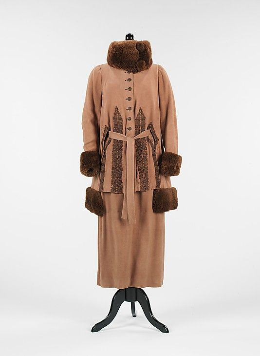 "Brown wool and silk suit with fur trim, French, 1920. This suit represents the quintessential style of the 1920s and marks a transitional moment in fashion, as the silhouette changed. Perhaps the most defining characteristic is the large, standing and wrapping collar, also known as the ""chin chin collar."" Collars such as this were given this name as a reference to similar Chinese styles. This is a very high quality piece, complete with refined lining and detailed buttons."