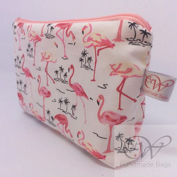 This lovely Flamingo 100% cotton fabric has been used to make a quirky make up bag. The bag is approx 7x 5x 1, has a white waterproof lining and an ivory zip. A very handy sized bag, perfect for keeping in your handbag! Perfect for a teenager, grown up or even a great stocking filler!