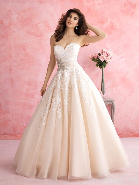 This Allure Bridals ballgown is for the lover of all things feminine. It features a floral patterned lace, tulle and a gorgeous Swarovski crystal accent.