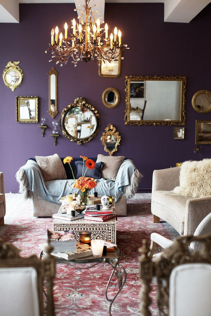 What a fab boho chic room. Loving this space with the royal purple walls.