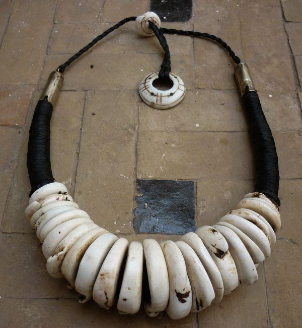 Necklace    Faouzi Designs. Conus shell, fiber and metal