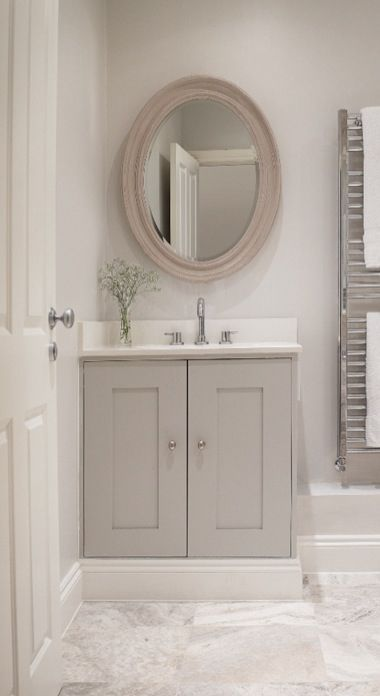 Country chic bathroom - nice colour for vanity and I like the marble splashback