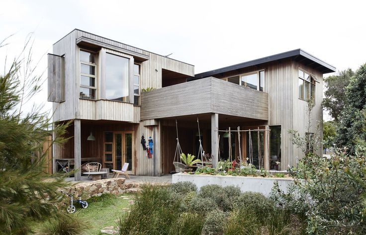 Exterior of the house / backgarden (shame no blue sky on the day we visited!).  Garden by DMS Landscapes. Photo – Eve Wilson, production – Lucy Feagins / The Design Files.