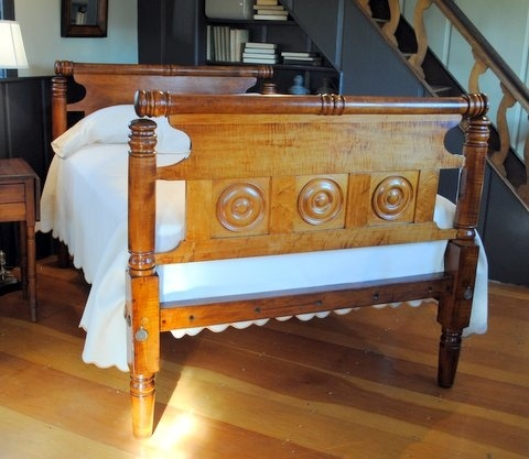 This bed has my name on it.....Original double size, circa 1850. Features a unique bull's-eye panelled rolltop repeat end footboard and single panel rolltop repeat end headboard. Accomodates a standard double size mattress on foundation.