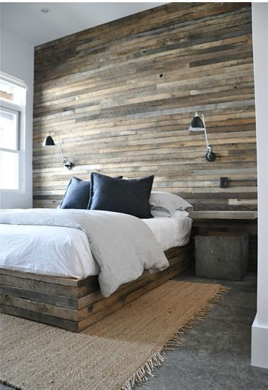 Stunning salvaged wood wall + built-in furniture treatment. [ SpecialtyDoors.com ] #bedroom #hardware #slidingdoor