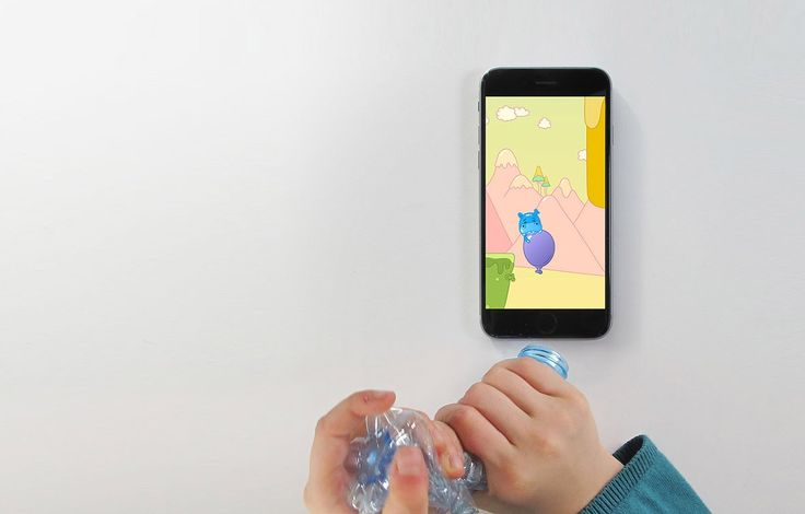 See children playing a game controlled by a plastic bottle.